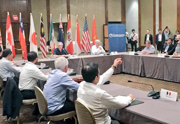 Les ministres du Commerce des 12pays membres du PTP. Crédit photo: Twitter/Trevor Kincaid