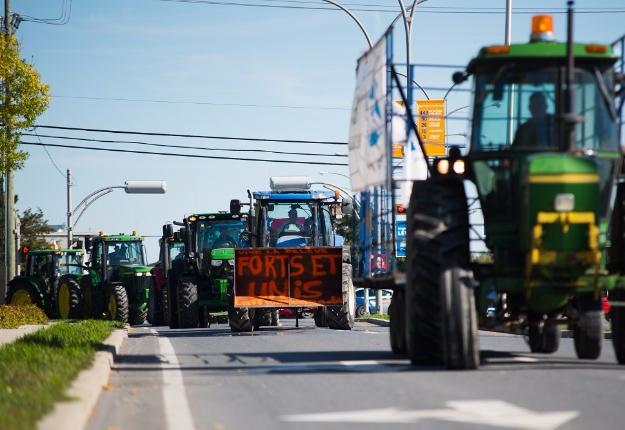Producteurs laitiers et agriculteurs se donnent rendez-vous sur la colline parlementaire à Ottawa, le jeudi 2 juin prochain. Crédit photo : Archives/TCN