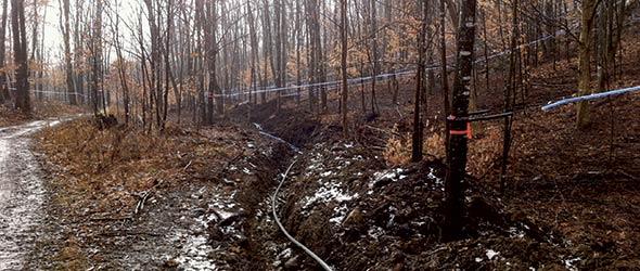 Pour éviter le gel, la famille Breault a installé ses tuyaux à environ trois pieds sous terre. Crédit photo : Gracieuseté de Guy Breault