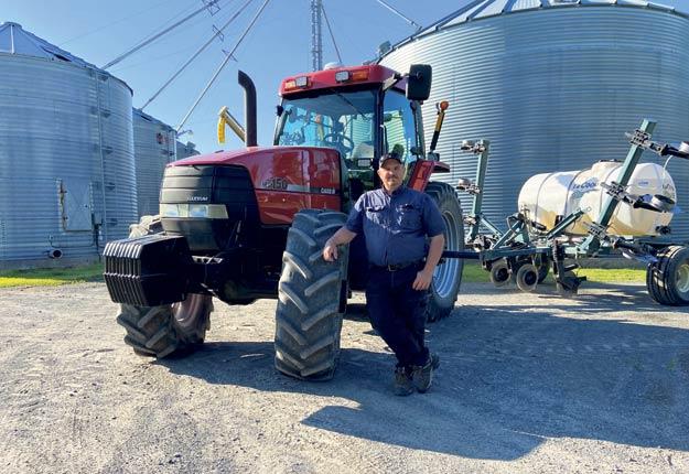 Le producteur agricole Christian Dionne, de La Visitation-de-Yamaska, se réjouit d'avoir accès à de l'équipement performant grâce à la CUMA qu'il préside. Photo : Gracieuseté de Christian Dionne